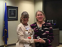FBINOCAAA President Leisa Farrar presenting Marshal May a Chapter Challenge Coin as token of our appreciation.